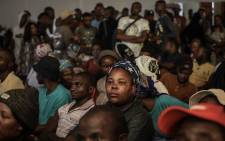 People displaced by the Tshwane floods listen to Gauteng Premier David Makhura at the Mamelodi Baptist Church on 11 December 2019. Picture: Abigail Javier/EWN