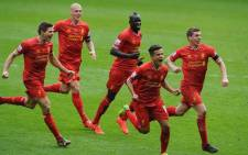 Liverpool's Philippe Coutinho celebrates his goal with team mates against Manchester City in the English Premier League on 13 April 2014. Liverpool won the match 3-2. Picture: Facebook.