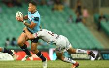 The Waratahs' Israel Folau (L) is tackled by the Crusaders' Ryan Crotty (R) during their Super Rugby match at the Sydney Cricket Ground in Sydney on 23 March 2019. Picture: AFP