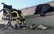 Quadriplegic athlete Pieter du Preez' wheelchair, shoes and gym bag lie next to the swimming pool while he completes his gruelling weekly training regime. Picture: Reinart Toerien/EWN.