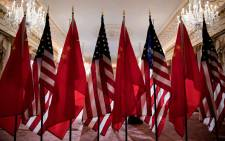 FILE: US and Chinese flags are seen as Secretary of State Mike Pompeo and China's Foreign Minister Wang Yi meet at the US Department of State 23 May 2018 in Washington, DC. Picture: AFP