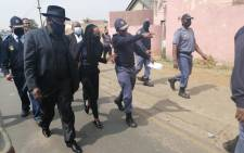 Police Minster Bheki Cele (left) visited Eldorado Park on 28 August 2020 after 16-year-old Nathaniel Julius was shot dead, allegedly by police. Picture: SAPS.