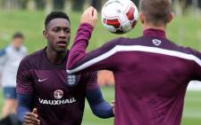 Englands forward Danny Welbeck (L) in action during a team training session at St Georges Park in central England, on 5 September, 2014. England play their first Euro 2016 qualifier against Switzerland in Basel on Monday 8 September, 2014. Picture: AFP.