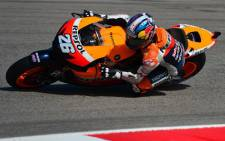 Spanish rider Dani Pedrosa steers his Honda to take the pole position during the qualifying practice of the San Marino Moto Grand Prix on September 15, 2012 at the Misano world circuit in Missano Adriatico. Picture: AFP.