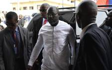 Liberia's president-elect and former football star George Weah arrives for a church service at the centennial memorial pavilion in Monrovia on 21 January 2018, the eve of Weah's inauguration. Picture: AFP.