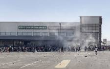 Rioters loot the Jabulani Mall in Soweto on 12 July 2021. South Africa's army said Monday it was deploying troops to two provinces, including its economic hub of Johannesburg, to help police tackle deadly violence and looting as unrest sparked by the jailing of ex-president Jacob Zuma entered its fourth day. Picture: Luca Sola/AFP