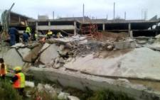 FILE: Emergency and construction workers among the rubble at the site of a collapsed mall in Tongaat, KwaZulu-Natal, on 19 November 2013. @CrisisMedDbn/Twitter.