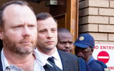Murder accused Oscar Pistorius is escorted out of the North Gauteng High Court on 8 August 2014. Picture: Christa Eybers/EWN.