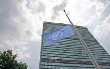 A view of the Secretariat Building, with a flag flying in the foreground, at United Nations headquarters in New York. Picture: United Nations Photo.
