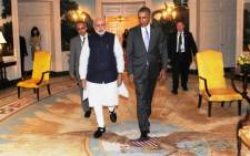 FILE: Indian Prime Minister Narendra Modi (centre L) walks with US President Barack Obama at the White House in Washington, DC, on 29 September, 2014. Picture: AFP.