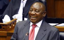 FILE: South Africa's new president Cyril Ramaphosa smiles as he delivers a speech after being elected by the Members of Parliament during his swearing in ceremony at the Parliament in Cape Town, on 15 February 2018. Picture: AFP