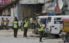 Pakistani security officials inspect the scene of a bomb attack in Lahore on 5 April 2017.. Picture: AFP