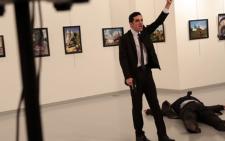 A screengrab of the gunman brandishing a gun after shooting the Russian ambassador to Turkey Andrei Karlov.