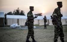 urundian soldiers patrol during the construction of several marquees on the outskirt of Musaga neighbourhood in Bujumbura on 28 June, 2015. The marquees will be used as polling places, away from the restive district center. Picture: AFP.