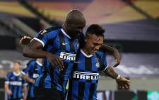 Inter Milan's Belgian forward Romelu Lukaku celebrates scoring the 4-0 goal with his team-mate Inter Milan's Argentinian forward Lautaro Martinez during the UEFA Europa League semi-final football match Inter Milan v Shakhtar Donetsk on 17 August 2020 in Duesseldorf, western Germany. Picture: AFP