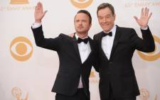 Breaking Bad actors Bryan Cranston (R) and Paul (L) arrive on the red carpet for the 65th Emmy Awards in Los Angeles, California, on 22 September 2013. Picture: AFP/Robyn Beck