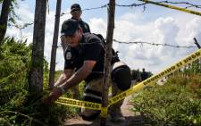 Members of the local attorney's opffice cordon off on 17 September 2018, the site where a mass grave was found in El Arbolillo, Alvarado municipality, in the Mexican southeastern state of Veracruz, a region hit by bloody drug cartel turf wars. Picture: AFP