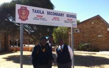 Children stand outside Taxila Secondary School in Polokwane, Limpopo. Picture: Tara Meaney/EWN