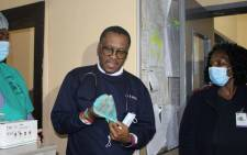 FILE: Former Gauteng Health MEC Bandile Masuku at the Soshanguve CHC to join the night shift as part of his voluntary clinical work. Picture: @GautengHealth/Twitter