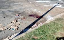FILE: Blood stains on the street where one of the two bodies were found in Langlaagte last night in another violent attack linked to the Soweto looting on 26 January 2015. Picture: Gia Nicolaides/EWN.