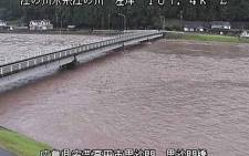 This video grab taken on 13 August 2021 from a video image released by Ministry of Land, Infrastructure, Transport and Tourism and received via Jiji Press shows the Gonokawa river, where the water level rose due to heavy rain in Akitakata City, Hiroshima Prefecture. Picture: Handout/Ministry of Land, Infrastructure, Transport and Tourism/JIJI PRESS/AFP