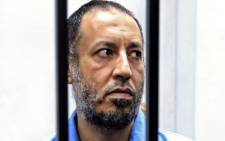 In this file photo taken on 6 December 2015 Saadi Kadhafi, the son of slain Libyan dictator Moamer Kadhafi, sits in the accused cell during his trial in a courthouse in the Libyan capital Tripoli. Picture: AFP