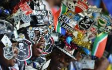Olando Pirates' supporters cheer during the African Champions League first leg final between the Buccaneers and Egypt's Al-Ahly on November 2, 2013.Picture: AFP