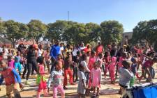 The children and adults of Jeppestown are being led by instructors in song, dance and sport at the park. Picture: Katleho Sekhotho/EWN