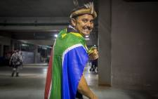 South African Martin van Staden holds up a toy olympic medal and the South African flag following Caster Semenya's win in the women's 800m race in Rio de Janeiro on 21 August 2016. Picture: Reinart Toerien/EWN.