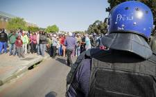 FILE: Police were called in to disperse hundreds of unruly protesters during their march to the Theewaterskloof Municipal office on 15 September 2014. Picture: Thomas Holder/EWN