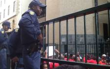 Police keep an eye on Parliament workers on 8 September 2016 during a protest. Picture: Gaye Davis/EWN.