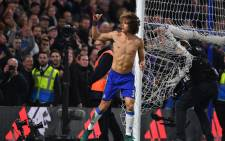 Chelsea's Brazilian defender David Luiz celebrates at the end of the English Premier League football match between Chelsea and Tottenham Hotspur on 26 November 2016. Picture:AFP.