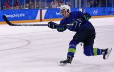In this photo taken on 17 February 2018 Slovenia's Ziga Jeglic scores the game-winning goal against Slovakia during a penalty-shot shootout in the men's preliminary round ice hockey match between Slovakia and Slovenia during the Pyeongchang 2018 Winter Olympic Games at the Kwandong Hockey Centre in Gangneung. Picture: AFP