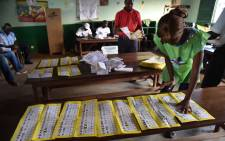 FILE: Election workers count votes after polls closed during the presidential and legislatives elections in Bangui's city center on 30 December, 2015. Picture: AFP.