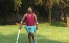 Ipeleng 'The Crutch Runner' Khunou preparing for the 2018 Two Oceans Marathon. Picture: YouTube screengrab.