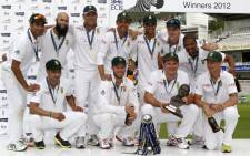 The South African team celebrates with their trophies after winning the third Test against England and securing the Test series 2-0 at Lord's cricket ground in London on August 20, 2012. Picture: AFP.