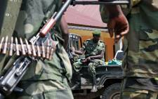 M23 rebel soldiers keep guard during the inauguration of newly elected M23 Rebel political wing President, Bertrand Bisimwa in Bunagana on March 7, 2013. Picture: AFP/ISAAC KASAMANI