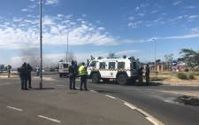 Metro police officers monitor a protest in the Bloekombos area in Kraaifontein on 24 March 2021. Picture: Graig-Lee Smith/Eyewitness News