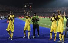 Zimbabwe players greet their fans after the 2019 Africa Cup of Nations (CAN) football match between Uganda and Zimbabwe at the Cairo International Stadium on 26 June 2019. Picture: AFP