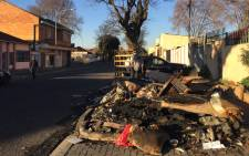 Debris left on the street outside the home of hip hop DJ C-Live Tshabalala where his 11-year-old son burned to death after fire broke out. Picture: Emily Corke/EWN.