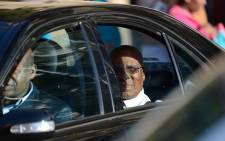 FILE: Andrew Mlangeni (back of the car), a former Robben Island inmate, leaves the MediClinic Heart Hospital in Pretoria after paying a visit to former President Nelson Mandela on 1 July 2013. Picture: AFP