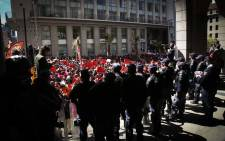 Police guarded the entrance to the provincial legislature as a procession of COSATU protesters gathered outside. Picture: Cindy Archillies