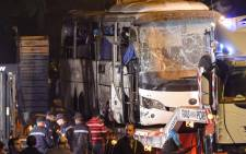 This picture taken on 28 December 2018 shows a tourist bus which was attacked being towed away from the scene, in Giza province south of the Egyptian capital Cairo. Two Vietnamese holidaymakers and an Egyptian tour guide were killed and 10 others wounded when a roadside bomb exploded near their bus as it travelled close to the Giza pyramids in Cairo, Egypt's interior ministry said in a statement. Picture: AFP