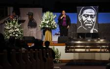 Ivy McGregor reads a resolution during the private funeral for George Floyd at The Fountain of Praise Church on 9 June 2020 in Houston, Texas. Floyd died after being restrained by Minneapolis Police officers on 25 May, sparking global protests. Picture: AFP.
