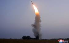 """This picture taken on 30 September 2021 and released from North Korea's official Korean Central News Agency (KCNA) on 1 October shows a test-fire of a """"newly developed"""" anti-aircraft missile carried out by the Academy of Defence Science of the DPRK. Picture: STR/KCNA VIA KNS/AFP"""
