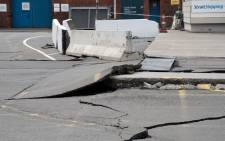 Damage to the road on the Wellington water front after a 7.8 earthquake centred in the South Island, in Wellington on 14 November 2016. Picture: AFP.