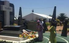 The Tambo family, followed by ANC members, place wreaths before the grave of Oliver and Adelaide Tambo. Picture: Victor Magwedze/EWN.