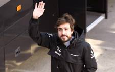 McLaren Honda's Spanish driver Fernando Alonso waves during the Formula One pre-season second day test at Catalunya's racetrack in Montmelo on 20 February, 2015. Picture: AFP.