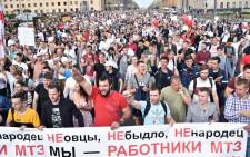 People shout slogans during a protest rally against police violence during recent rallies of opposition supporters, who accuse strongman Alexander Lukashenko of falsifying the polls in the presidential election, in Minsk on 14 August 2020. Picture: AFP