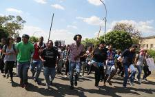 A small group of Wits university students joined campus staff who protested over issues of employee outsourcing on 28 October 2015. Picture: Reinart Toerien/EWN